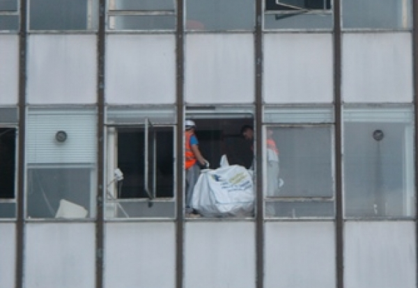 Builders Hurl Rubble Sacks From Fifth Floor Window