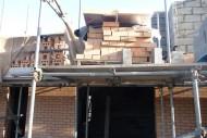 Stacked-bricks-on-scaffolding