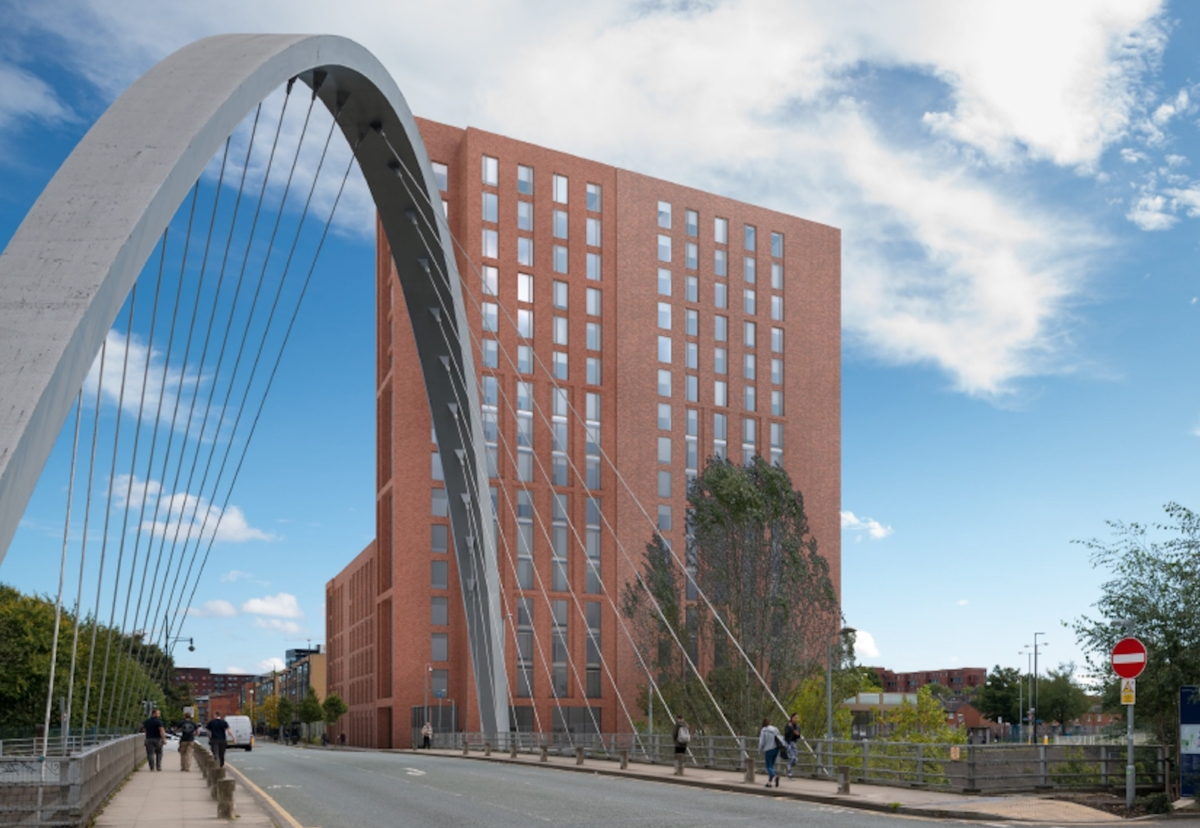 The site, known as Plot E, sits close to the Hulme Arch on Stretford Road