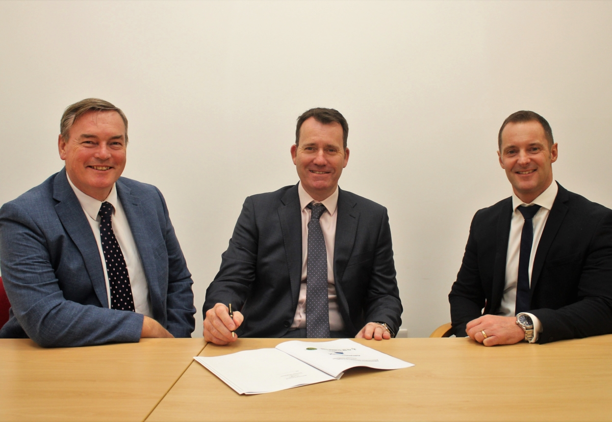 The new collaboration agreement is signed by (from left to right) Stuart Herritty, Director of G M Treble; Phil Leech, Managing Director of J S Wright; and Glynn Williams, Director of Sales, Commercial Building Services for Grundfos Pumps