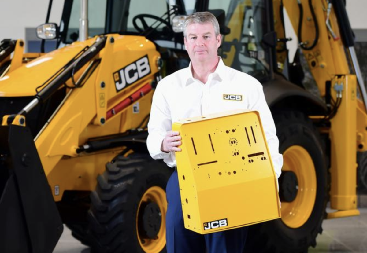 JCB chief innovation and growth officer Tim Burnhope pictured with the ventilator housing prototypes