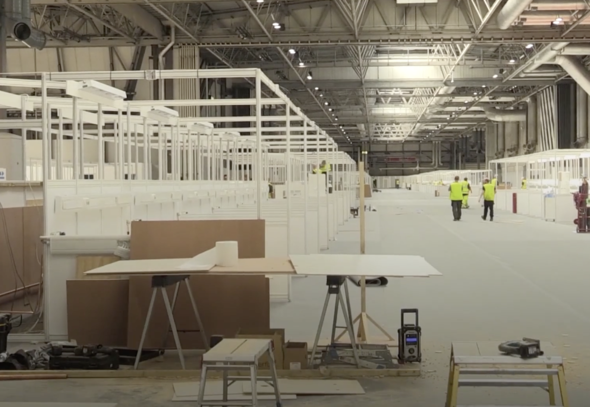 Workers fast-track conversion of NEC hall