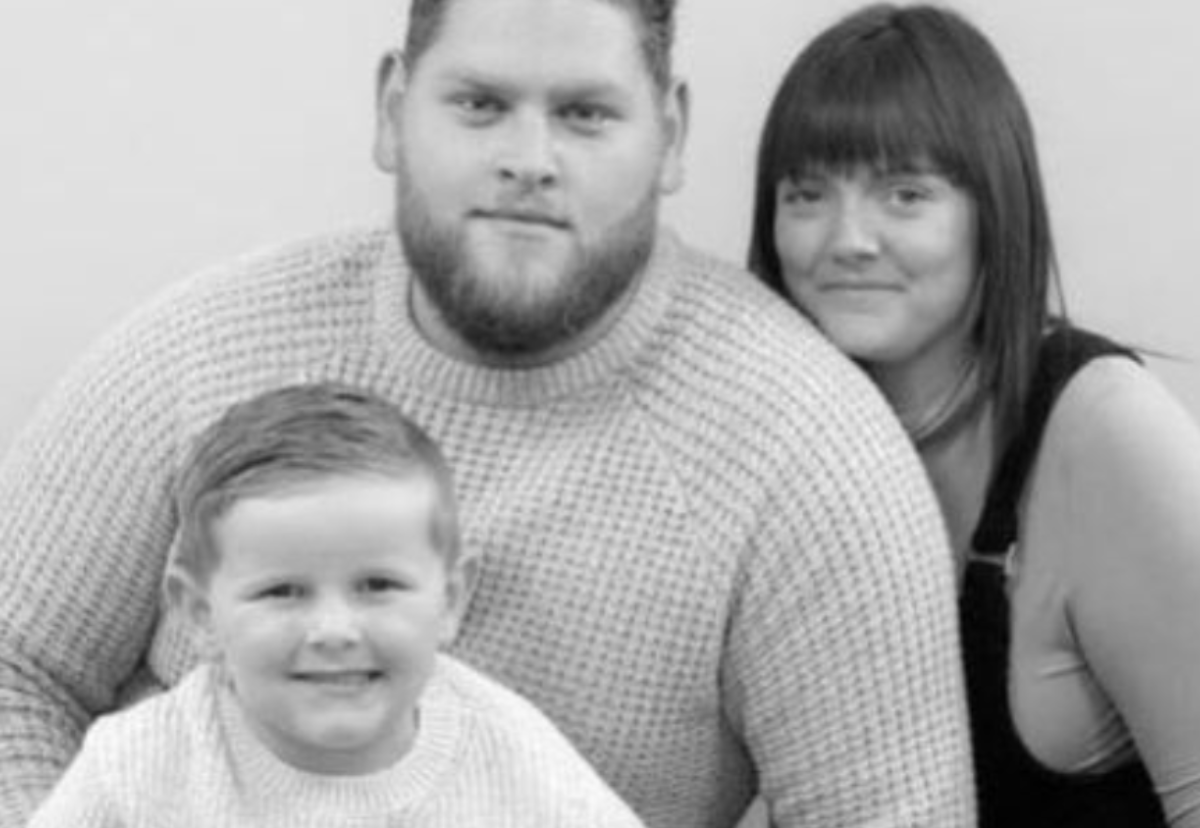 Victim Scott Grimes with his wife and young son