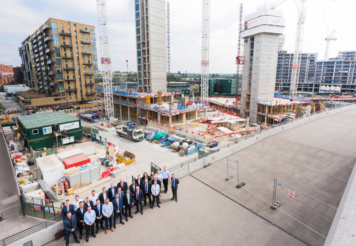 The Wates team in front of ongoing work at Wembley Park