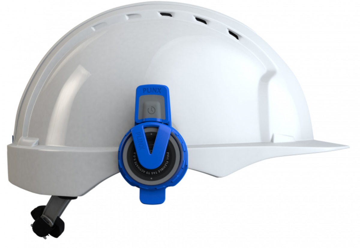 Hard hat fitted with social distancing alarm